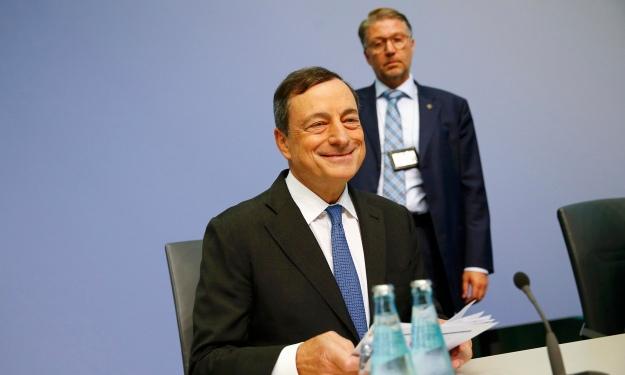 En glad bankchef på dagens presskonferens: Mario Draghi, ECB. Photograph: Kai Pfaffenbach/Reuters